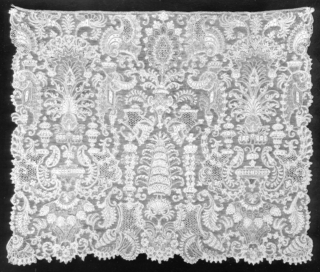 Cravat end with a central design of abstract foliated forms flanked by identical stylized representations of trees surrounded by an intricate pattern of volutes, urns, and rocaille decoration.