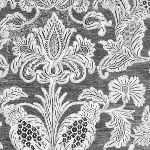 Symmetrical lace pattern with scrolling floral and foliage motifs and scalloped edges.