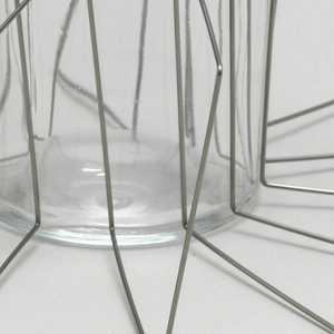 Steel wire bent to form flexible bracelet of continuous square sections.