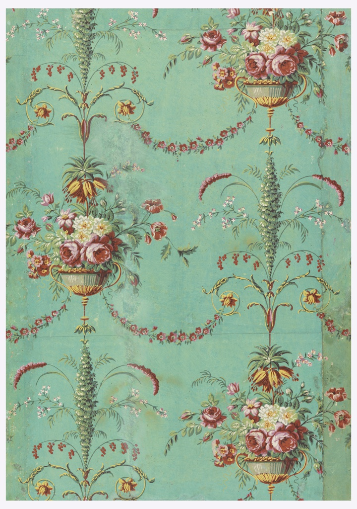 Repeating design of floral arabesques and scrolls, with pink and white roses, and fuchsias in a vase. Printed on a green ground. Vertical rectangle.