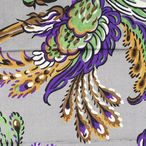 Gray ground with brilliant purple, orange, green, black, white, and brown printed design of fantastic birds, likely adapted from the Chinese phoenix, arranged in horizontal rows, alternate rows facing up and down. One selvedge present.