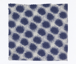 Sample of white silk twill weave printed with blue polka dots. Blue dots are comprised of clusters of small dots printed closely together. Spaces between dots are lightly printed with small dots in the same color.