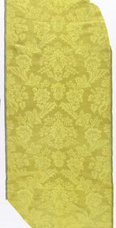 Full width filled with a single vertical repeat of symmetrical bouquet of delicate spreading flowers in continuous ogival flowery framework. Broadcloth and warp twill selvages with narrow dark green and white stripes.