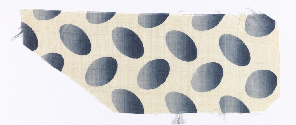 Silk textile printed with pattern of blue ombre ovals against a white ground.
