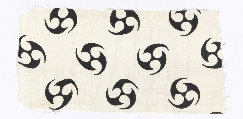 Silk textile printed with pattern of black spirals on a white ground.
