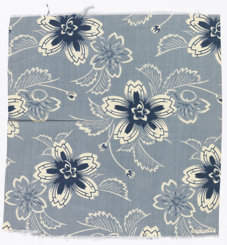 Silk textile printed with pattern of white and navy flowers against a blue ground.