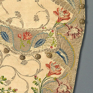 Left and right fronts of a gentleman's waistcoat. Large metallic scrolls and polychrome silk flowers on a textured ivory ground. Brocaded in 13 colors of silk and 6 metallic yarns.