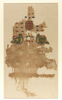 Fragment of woven wool with polychromy design showing a pair of facing birds, floral medallion and dark shapes. In main body of the garment, at given intervals, triple weft threads are run through.  Mounted on plain weave linen.