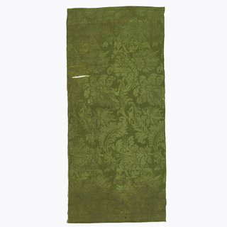 Seven lengths of antique silk damask in olive green color; saymmetrical floral pattern of baroque character.