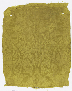 One motif visible in a large-scale yellow damask with a symmetrical design or mirror image on the center line of an elaborate exotic plant form with long slender leaves.