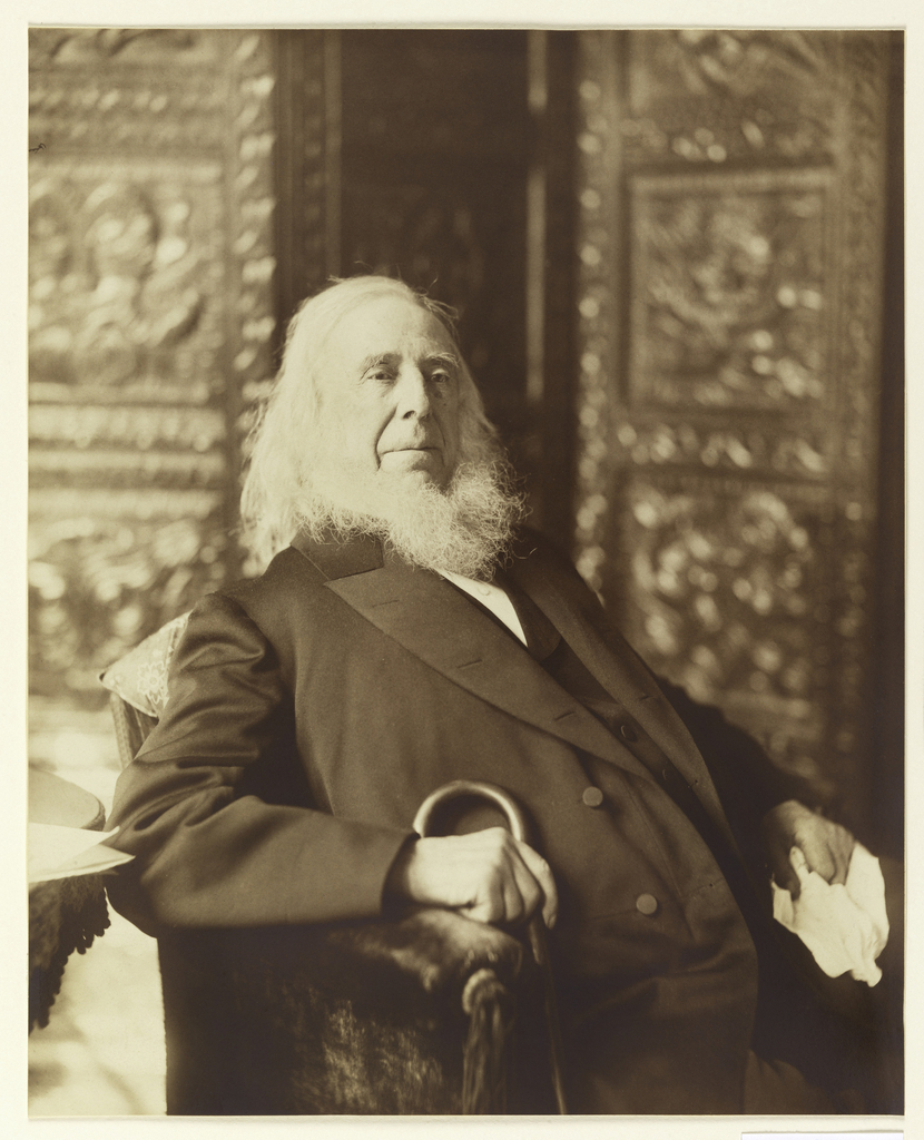 A three-quarter length portrait of Peter Cooper, facing right. He is seated in an armchair, his cane held in his right hand.