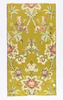 Yellow satin ground. The design consists of a large ogive the full width of the textile, formed of irregularly disposed leaf and floral branches.  From the bottom of the ogive two floral branches extend to the center to support two confronted doves with a bow and quiver under each.  On the upper branches of the ogive are seated two confronted chinoiserie figures, each holding a dove.