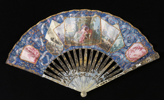"Pleated fan. Leaf of painted parchment backed with painted paper; sticks of incised and pierced mother-of-pearl with applied metallic foil; glass stone at the rivet. The figures in the central frame are after a painting by Jean Baptiste Joseph Pater (1695-1736) entitled, ""Conversation Galante dans un Parc."" The partially visible pen and ink drawing on the left is signed Perelle and is probably a copy of a countryside view by the painter and engraver, Gabriel Perelle (1603-77). Scattered framed pictures and the twisting ribbon motif create a trompe l'oeil effect."