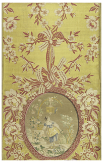 Panel of red, yellow and white woven silk with inset panel of pale tones showing a woman with a basket of flowers. The inset panel is earlier than the background fabric. Panel was used as a wall covering. There are still traces of glue on the back.