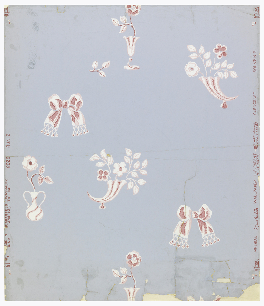 Full width, showing drop-repeating bow, rose in vase, and flowers in cornucopia, in pink and white on blue-grey ground.