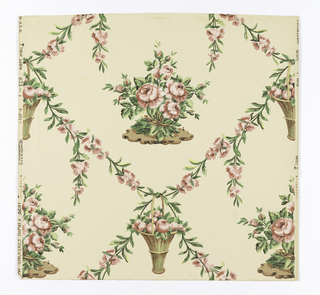Design of flowering rose stems crossing to form lozenge shapes; a basket of roses at each crossing; rose plant within each lozenge. Printed in white, pink, green, yellow and brown on light pink.