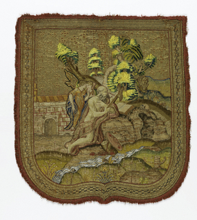 Shaped cope hood with embroidered picture of St. Jerome in the desert in colored silks on a metallic gold background.
