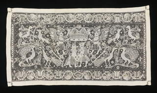 Horizontal rectangle of knotted net embroidered with the design of a couple under a crown. Pairs of birds are on either side of the couple. A one inch band of plain weave linen borders the knotted net.