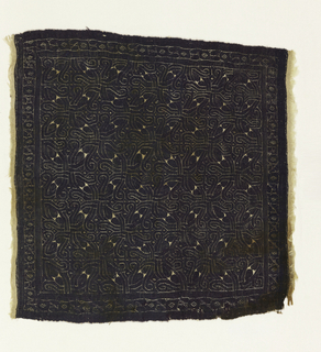 Square of purple tapestry cut from its linen foundation. Geometric pattern based on interlocking circles.