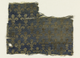 Pattern of metallic fleur de lys on blue background.