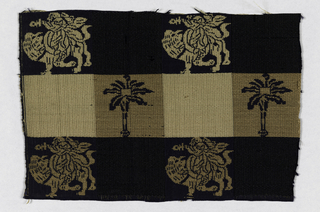 Large checker pattern formed by color and weave structure in black, dark beige, and light beige.  Woven motifs of palm tree and a warrior brandishing a sword while riding a camel