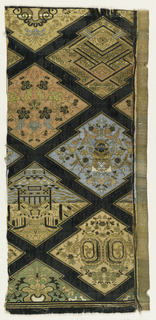 Large jagged diaper pattern in dark green. Each diamond contains a different intricate pattern including geometric motifs, flowers, and leaves in green, blue, red, beige, and gold.