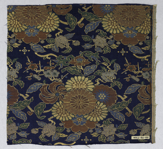 Dark blue ground with groups of flowers and flowering branches with leaves. Pattern formed by weft floats in red, blue, green and pink silk with gold gilt paper threads.