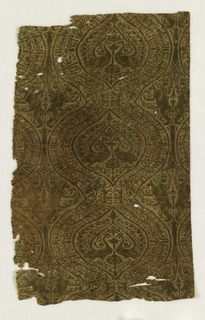 Vertical rows of medium-sized ogives bordered with broad continuous bands of Kufic lettering and enclosing confronted peacocks with tails spread to top of a Tree of Life between them. Winged sphinxes, addorsed regardant, in interspaces. Olive-green floss in cloth tie on golden tan fine cloth ground.