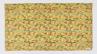 Yellow ground with allover pattern of clouds and bats organized in horizontal rows.  In green, red and blue silk.