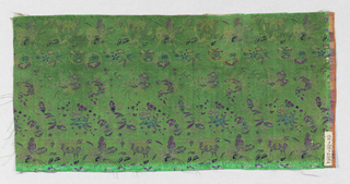 Green satin ground with horizontal pattern of flowers and butterflies in purple, blue and yellow silk.