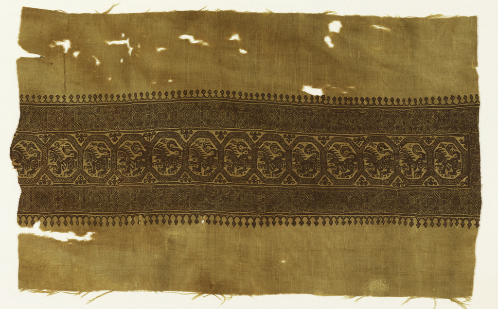 Wide band showing lions in octangonal medallions with border of latticework. Maroon design on a tan ground.