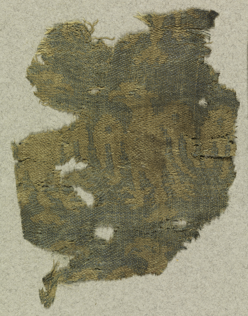 Fragment of woven silk with a pattern of rows of eagles in beige and blue.