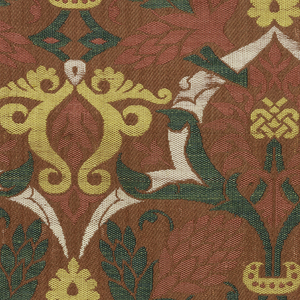 Curving stems with blossoms and pomegranates and areas of interlaced strapwork in rose, yellow, green and white on a red ground.