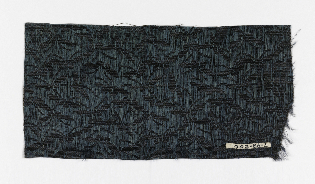 Allover pattern of small butterflies reserved in plain ribbed cloth on a black ground formed by extra warps in dark teal carried on the face of the material in long floats