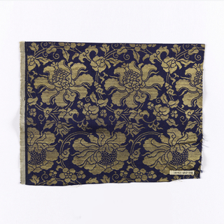 Dark blue ground with large weft pattern of chrysanthemums and vines in gold covered paper.