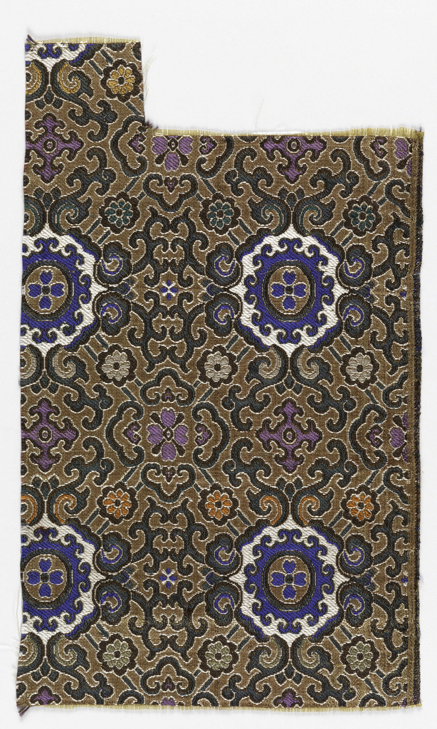 Allover geometric latticework design in blue, purple, green and light gray on a tan ground.