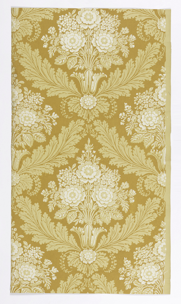 Foliate diaper pattern with inset floral bouquets. Printed in shades of yellow on ocher ground.