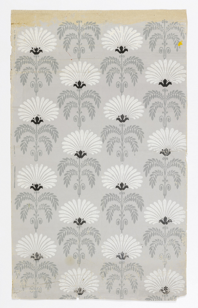 Repeating motif of foliage with flower. Printed in green, white, black on gray.