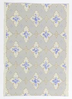 Repeating pattern of floral cartouches alternating with smaller motif. Blue floral sprig in cartouche. Printed on white satin ground.