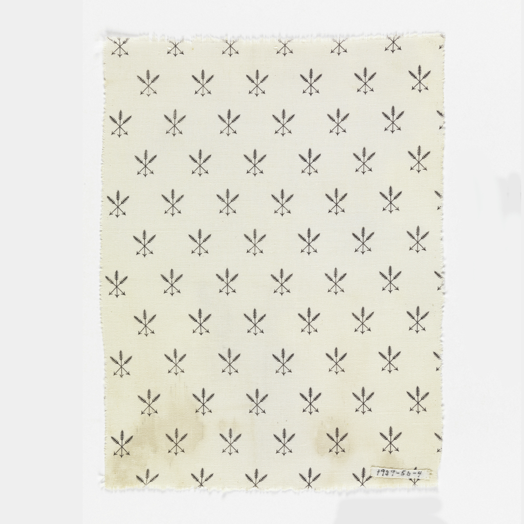 White fabric in a printed design showing groups of three intersecting arrows in diagonal lines.