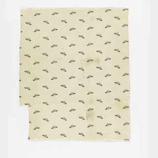 White fabric printed in a design showing a repeating motif of a hat with a rolled brim and flower.