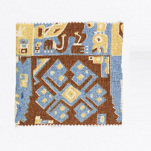 Fragment showing a design comprised of four blocks, three based on a human figure, and one with an interlacing design, in blue, yellow and brown. Design inspired by motifs found on the textiles of mummy bundles from the Bolivian Andes.