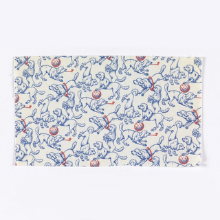 Woven cotton printed in blue and red on white ground showing a pattern of poodles in a variety of playful poses.