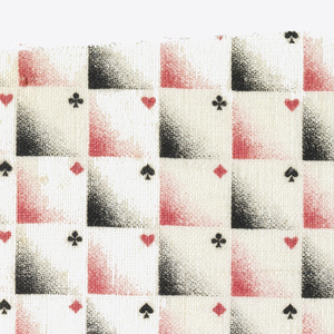 Woven cotton textile printed in black and red on white ground showing a checkerboard pattern; in each square an ombre of red or black fills the lower left corner, and the upper right corner contains a card suit (spades, clubs, diamonds, hearts).