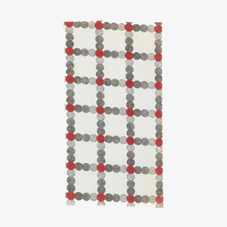 Woven cotton textile printed in black and red on white ground showing a grid pattern composed of circles in various shades.