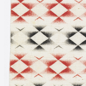 Woven cotton textile printed in black and red on white ground showing a grid pattern composed of diamonds with gradient corners.