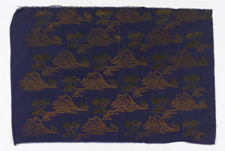Dark blue cotton printed in red pigment and gold with oriental tree-and-mountain motif.