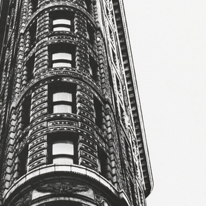View from below of the Flatiron building in New York City on white background. Imprinted in red ink, upper left: The Rise/of an /American /Architecture; in blue ink, upper center: Now/through/October 4th/1970; in grey ink, upper right: The Metropolitan/Museum of Art/1870/1970. In gray, lower right: Admission / to this exhibition and to / 19th-Century America: / $1.00, students 50©; / free Mondays