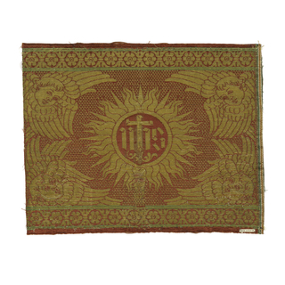 "Sunburst with the monogram ""IHS' on a checkerboard background with cherubs.  Partial selvage on right."
