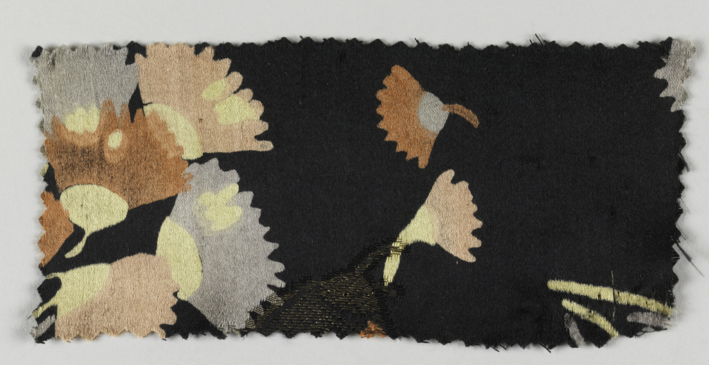 Black ground with flowers in gold.